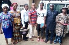 Ofonbuk Udom with some brethren after Baptism